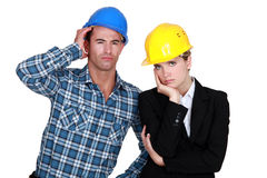 Annoyed construction worlers Stock Images