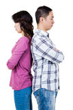 Annoyed couple with backs to each other. Against white background royalty free stock photography
