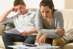Annoyed couple calculating their finances. During recession Stock Photo