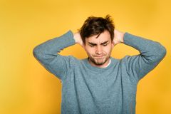 Annoyed discontent frustrated disgruntled man royalty free stock photography