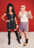 Annoyed Dominatrix and Client. Dominatrix women is annoyed as her client complains to her Royalty Free Stock Photo