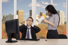 Annoyed employee with her manager in autumn background Royalty Free Stock Images