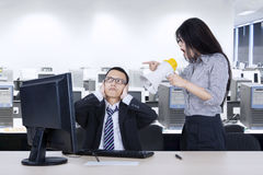 Annoyed employee with her manager in the workplace Stock Photos