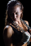 Annoyed female athlete holding chain Royalty Free Stock Photography