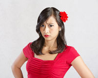 Annoyed Female in Red Stock Photo