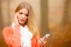 Annoyed girl listening music mp3 Stock Image