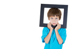 Annoyed kid insisting that his photo has to be taken Royalty Free Stock Images