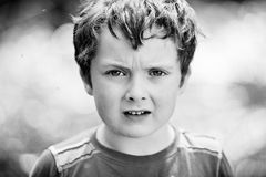 Annoyed little boy royalty free stock images