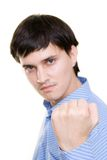 Annoyed man. Man showing his fist, focused on fist Royalty Free Stock Photo
