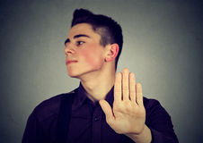 Annoyed man with bad attitude giving talk to hand gesture Royalty Free Stock Photography