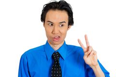 Annoyed man giving victory sign Royalty Free Stock Photography