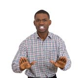 Annoyed man raising hands to say stop right there Royalty Free Stock Photos