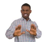 Annoyed man raising hands to say stop right there Royalty Free Stock Images