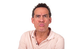 Annoyed Man Sticking Out Tongue Pulling Face. Annoyed Miidle Age Man Sticking Out Tongue and Pulling Silly Face Stock Photo