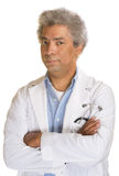 Annoyed Mature Doctor. With arms folded on isolated background Stock Photo