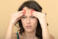 Annoyed Moody Unhappy Young Woman With a Painful Headache Stock Image