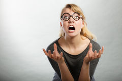 Annoyed nervous woman portrait. Anger and rage concept. Young expressive woman show her bad face. Angry nervous annoyed girl portrait. Human full of negative royalty free stock photo