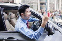 Annoyed person driving a car Stock Images