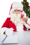 Annoyed santa claus on the phone Royalty Free Stock Photography