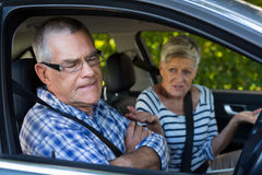Annoyed senior cpouple sitting in car. Annoyed senior man with woman sitting in car Stock Photos