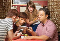 Annoyed Server with Distracted Customers Stock Photos