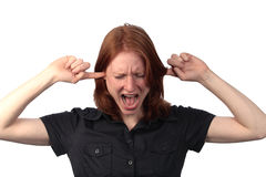 Annoyed by Sounds. A woman closing her ears with fingers and screaming out of annoyance or due to pain caused by loud sounds Stock Photos