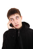 Annoyed Teenager with Cellphone. Annoyed Teenager in the Coat with Cellphone Isolated on the White Background Royalty Free Stock Photography