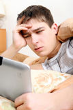 Annoyed Teenager with Tablet Royalty Free Stock Photos