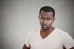 Annoyed unhappy young man looking at you camera Royalty Free Stock Images