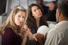 Annoyed Woman. With coworkers in office cubicle Royalty Free Stock Image