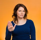 Annoyed woman with bad attitude, giving talk to hand gesture Royalty Free Stock Photo