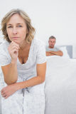 Annoyed woman looking at camera after fight with husband. Annoyed women looking at camera after fight with husband in bedroom at home Stock Image