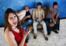 Annoyed Woman with Loud Men Stock Image