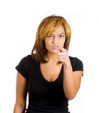 Annoyed woman pointing at the camera Stock Photos