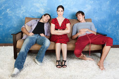 Annoyed Woman and Two Men. Annoyed women between two infatuated young men Stock Images