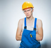Annoyed young builder Stock Images