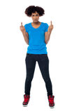 Annoyed young female showing middle finger Stock Photography