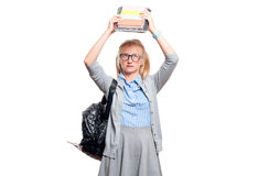 Annoyed young student girl holding books.  Back to school. Annoyed young student girl holding books, standing isolated on white background. Back to school Royalty Free Stock Photography