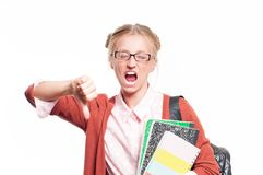 Annoyed young student girl holding books.  Back to school. Annoyed young student girl holding books, standing isolated on white background. Back to school Stock Image