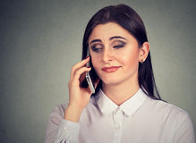 Annoyed young woman bored by long phone conversation royalty free stock photo