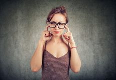 Annoyed young woman covering ears royalty free stock photo