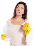 Annoyed young woman holding household detergent Royalty Free Stock Photos