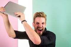 Annoying advertisement promoting brands on internet makes people go crazy angry aggressive. Man laptop annoyed by ads. Internet advertisement. Guy stylish stock images
