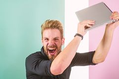 Annoying advertisement promoting brands on internet makes people go crazy angry aggressive. Man laptop annoyed by ads. Internet advertisement. Guy stylish royalty free stock photos