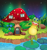An annoying frog near the red mushroom house Stock Photography