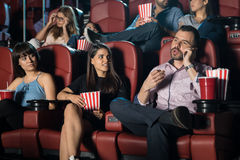 Annoying man at the movie theater Royalty Free Stock Images