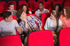 Annoying man on the phone during movie. Annoying men on the phone during movie at the cinema stock photo