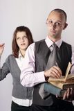 Annoying professor and teen age girl. Mad teacher holding books and  screaming loud at the camera and teen age girl making disappointing face looking at him Stock Image