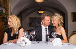 Annoying sweet couple getting on their friends nerves Royalty Free Stock Photo