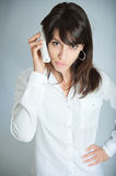 Annoying telephone conversation Royalty Free Stock Photo